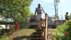 City workers tear down homemade wooden stairs at Tom Riley Park